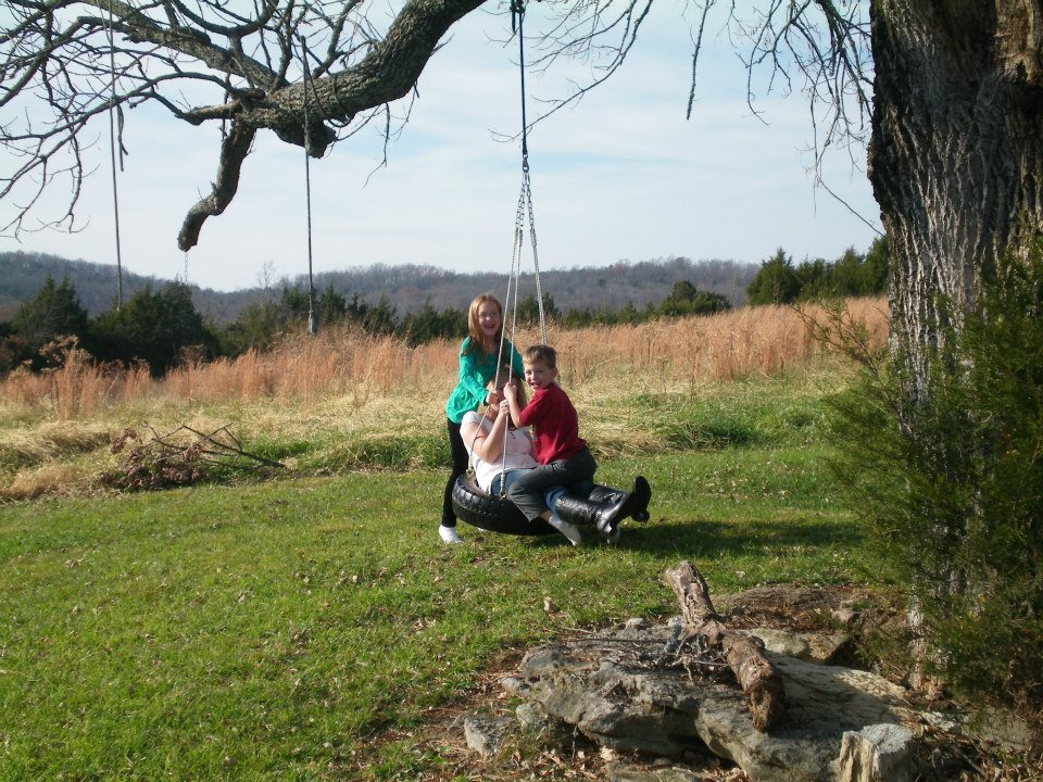 This is me with my kids on the tire swing at Grandma's house on Thanksgiving.