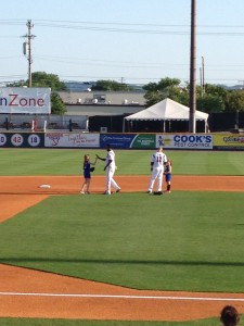 My shortstop high fives the Sounds shortstop!