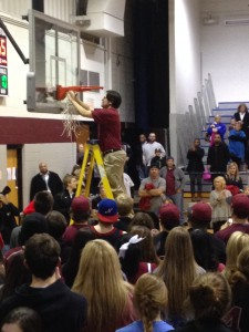 I cannot explain this strange tradition, but that is my husband cutting the net after a big win.